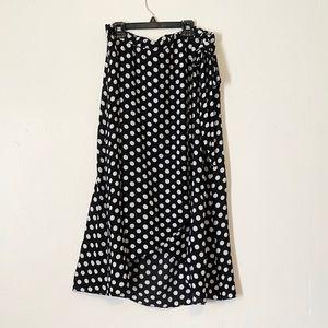 Green envelope black and white polka dot skirt